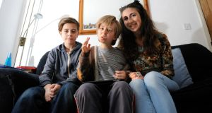 Adrienne Murphy, with her children Fiach (left) and Caoimh Connolly. Photograph: Dave Meehan