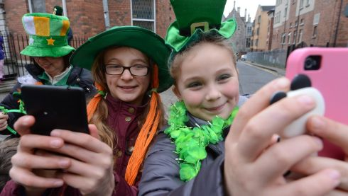 Two amateur photographers enjoy the Dublin St Patrick's Day parade. Photograph: Cyril Byrne.