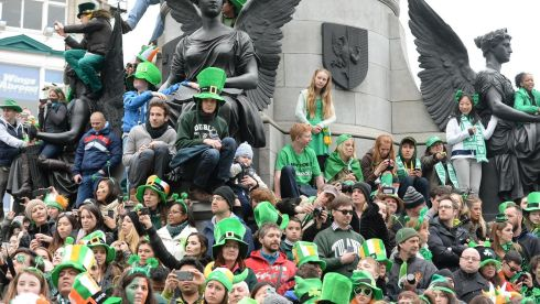 Crowds take an seat they can to get a view of the St Patrick's Day parade in Dublin. Photograph: Cyril Byrne.