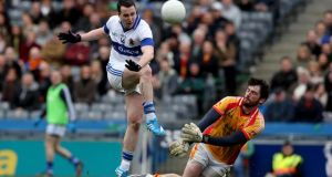 Castlebar goalkeeper Ciaran Naughton saves from Ciaran Dorney of St Vincent's during the AIB  All-Ireland Senior Club Football Final at  Croke Park. Photograph: Donall Farmer/Inpho