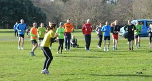 Mary Jennings leads runners in a warm-up before the St Anne's parkrun last Saturday where more than 250 people enjoyed a run in the sun. Photograph: Alan Betson