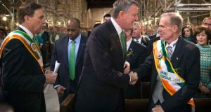 New York mayor Bill de Blasio greets John  Ahern, grand marshal of the 2014 New York St Patrick's Day Parade, yesterday. Photograph: Reuters/Lucas Jackson