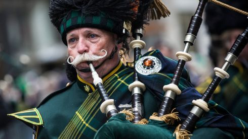 A bagpiper marches in the annual St. Patrick's Day Parade along Fifth Ave in Manhattan, New York. Photograph: Andrew Burton/Getty Images.