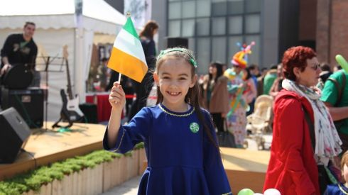 A girl waves an Irish flag at the 8th annual St Patrick's Day celebrations in Shanghai.