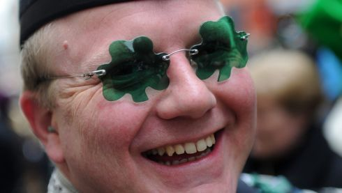 A man wearing shamrock-shaped glasses takes part in the St. Patrick's Day Parade in Munich, Germany. Photograph: Tobias Hase/EPA