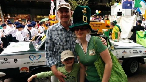 Martin Collyer and Melody O'Donoghue (originally from Cork) with their son Jim Collyer, with daughter Rose on a float in the background at the parade in Sydney.