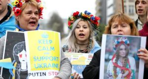 Ukrainians living in Belgium at a protest against Russia's incursion into Crimea, outside the meeting of European Union foreign ministers in Brussels yesterday. Photograph: Reuters/Francois Lenoir