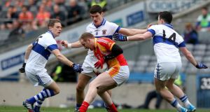 Castlebar's Tom Cunniffe is tackled by Tomás Quinn and man-of-the-match Diarmuid Connolly during yesterday's All-Ireland club football final. Photograph: Donall Farmer/Inpho