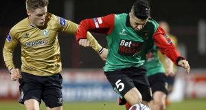 Glentoran's Danny McKee and Shamrock Rovers' Simon Madden during last night's 0-0 stalemate. Photograph: William Cherry/Inpho