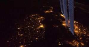The new commander of the International Space Station, Col Douglas Wheelock, included a photograph of Ireland by night which he had previously taken from the window of the ISS.