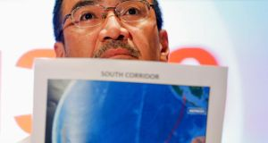 Malaysia's acting transport minister Hishammuddin Hussein shows one of the maps with corridors of the last known possible location of the missing Malaysia Airlines MH370 plane as he addresses reporters at the Kuala Lumpur International Airport March. Photograph: Damir Sagolj /Reuters