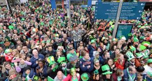 People watching from every vantage point in O'Connell Street, at the St Patrick's Day parade, in Dublin yesterday. Photograph: Eric Luke/The Irish Times
