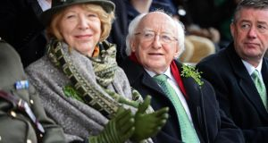 President Higgins and Mrs Higgins , at the St Patrick's Day parade in Dublin yesterday . Photograph: Eric Luke / The Irish Times