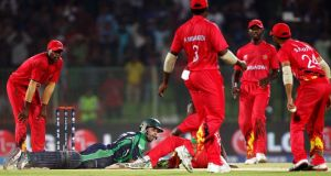 Ireland's Stuart Thompson lies on the ground after making his ground to secure the bye that gave Ireland a three-wicket win over Zimbabwe at the ICC World Twenty20 in Sylhet, Bangladesh. Photograph: Surjeet/Inpho