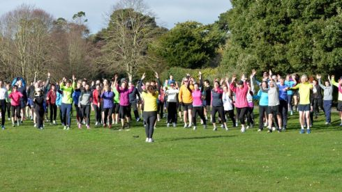 Runners at the St. Annes parkrun. Warm up exercise by Mary Jennings  