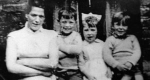 Undated handout photo of Jean McConville (left) with three of her children. Photograph: PA .