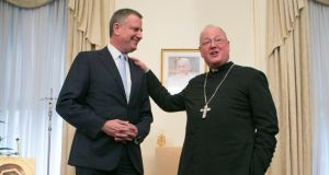 New York Mayor Bill de Blasio meets Cardinal Timothy Dolan at his residence in New York. Photograph: Fred R Conrad/The New York Times.