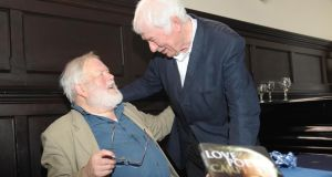 Michael Longley with Seamus Heaney at his 70th birthday celebration at Queen's University Belfast. Longley is to take part in a conference to mark what would have been Heaney's 75th birthday next month. Photograph: Colm Lenaghan/ Pacemaker