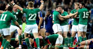 Irish players celebrate at the final whistle after clinching the Six Nations Championship with victory over France at the  Stade de France in  Paris. Photo: Billy Stickland/Inpho
