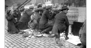 Men  at a barricade during the 1916 Rising. An Post has secured planning permission for a 1916 Rising exhibition and visitor centre for the GPO.