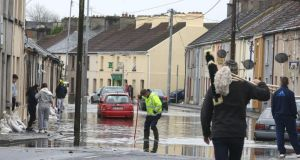 Householders react to flooding earlier this year. Photograph: Patrick Browne