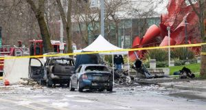 Wreckage is pictured where a television news helicopter crashed near the Space Needle in Seattle. Photograph: David Ryder/Reuters.