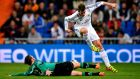 Gareth Bale of Real Madrid is tackled by Tim Hoogland of Schalke 04  at Estadio Santiago Bernabeu. Photograph:   Stuart Franklin/Bongarts/Getty Images