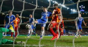 Chelsea's Gary Cahill (centre left) shoots to score the second against   Galatasaray at Stamford Bridge. Photograph: Eddie Keogh/Reuters