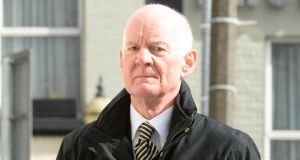 Former financial regulator Patrick Neary arriving at the Dublin Circuit Criminal Court yesterday to give evidence during the trial of three former directors of Anglo Irish Bank. Photograph: Dara Mac Dónaill