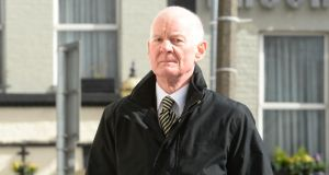 Former financial regulator Patrick Neary arriving at the Dublin Circuit Criminal Court to give evidence during the trial of three former directors of Anglo Irish Bank. Photograph: Dara Mac Dónaill