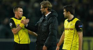 Borussia Dortmund's Kevin Grosskreutz, coach Juergen Klopp and Sokratis Papastathopoulos (l-r)  after their Champions League round of 16 second leg   match against Zenit St Petersburg. Photograph: Ina Fassbender/Reuters