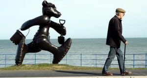 Passing the bronze teddy-bear sculpture by Patrick O'Reilly, which was commissioned in memory of  Caroline Dwyer-Hickey and now stands at the seafront at Greystones, Co Wicklow. Photograph: Eric Luke/The Irish Times