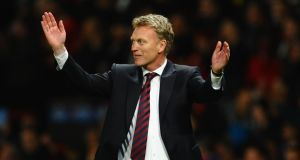 Manchester United manager David Moyes celebrates after his team's 3-0 victory over Olympiakos at Old Trafford last night.