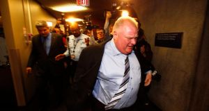 Toronto mayor Rob Ford tries to get away from media personnel  after exiting an executive council meeting in Toronto yesterday. Photograph: Mark Blinch/Reuters
