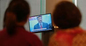 Journalists look at a TV screen broadcasting a news conference Malaysia's acting Transport Minister Hishammuddin Hussein on the missing Malaysia Airlines flight MH370, inside the hotel where are relatives of the passengers of the missing Boeing 777-200ER are staying. Photograph: Samsul Said/Reuters