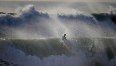 A bodyboarder rides the crest of a wave during Sumol Nazare Special Edition in Nazare.  Photograph: Rafael Marchante/Reuters