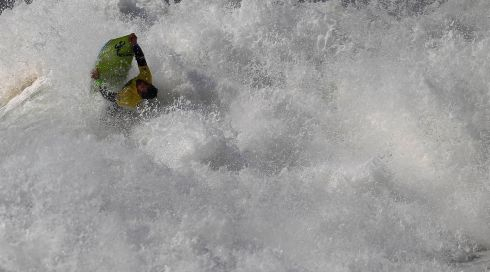A wild tumble in the surf. Photograph: Rafael Marchante/Reuters