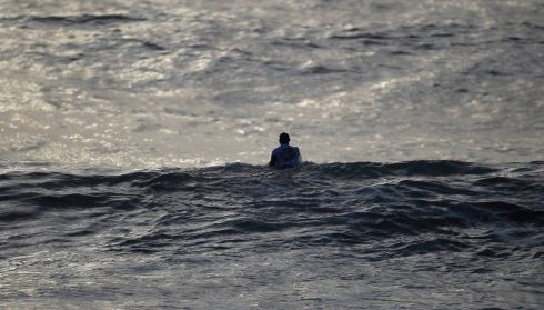 Man versus the ocean.  Photograph: Rafael Marchante/Reuters
