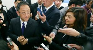Akio Toyoda (left), president of Toyota and chairman of Japan Automobile Manufacturers Association speaks with reporters after a news conference on prospects of domestic demand of automobiles in Tokyo. Photograph: Kimimasa Mayama/EPA