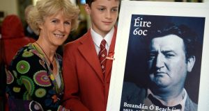 Blanaid Walker, daughter of Brendan Behan, with her son Rupert (13), at the launch today of a new commemorative stamp marking the 50th anniversary of the writer's death, at the GPO, Dublin. Photograph: Eric Luke/The Irish Times