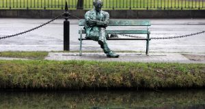 The statue of Patrick Kavanagh on the canal near Baggot Street bridge. Photograph: Eric Luke
