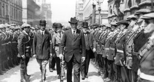 1914:  British politician Edward Carson inspects a parade of armed Ulster Volunteers, the Ulster Unionist paramilitary force, organised by the Ulster Unionist Council and founded by Carson.  (Photo by Central Press/Getty Images)