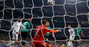 Schalke  goalkeeper Ralf Fahrmann  saves a header from Real Madrid's Cristiano Ronaldo.  Rivals in this morning's draw will be hoping defending champions Bayern Munich and La Liga leaders Real Madrid are drawn against each other.