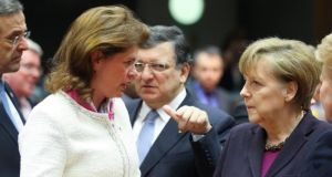 Slovenian prime minister Alenka Bratusek and German chancellor Angela Merkel at the start of the EU heads of state summit in Brussels yesterday. Photograph: Olivier Hoslet/EPA