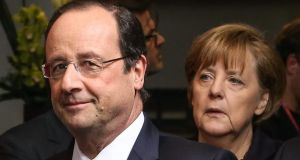 French President Francois Hollande and German Federal Chancellor Angela Merkel at the start of spring European head of states Summit at EU council headquaters in Brussels, Belgium on Thursday. Photograph: EPA