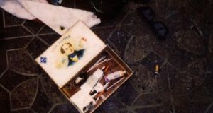 A police handout photo released by Seattle Police Department shows articles left at grunge rock musician Kurt Cobain's 1994 death scene. Photograph: Seattle Police Department