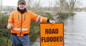 Up to his neck: Brian Keogh by his house, in Ballycar; the flooded sections of the road are up to 350m long. Photographs: Liam Burke/Press 22