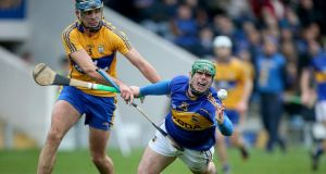 Tipperary's John O'Dwyer in action against Clare's Brendan Bugler during the recent league clash at Thurles. Photo: Ryan Byrne/Inpho