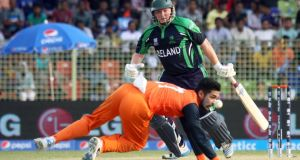 Ireland's Andrew Poynter is dropped by Ihsan Malik of the the Netherlands in their World Twenty20 Group B match in the International Cricket Stadium in Sylhet, Bangladesh. Photograph: Barry Chambers/Inpho
