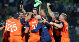 The Dutch players and backroom team celebrate after their stunning six-wicket victory over Ireland in Sylhet, Bangladesh that saw them qualify for the Super 10s stage of the World Twenty20. Photograph:   Barry Chambers/Inpho